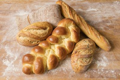 Baked loaves of bread. by John Burcham