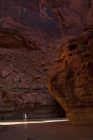 Hiker in Paria Canyon, Arizona by John Burcham