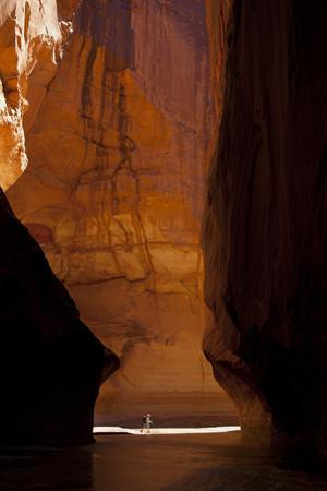 Hiker with Backpack in Paria Canyon, Arizona by John Burcham