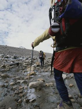 Hiking on Black Rapids Glacier by John Burcham