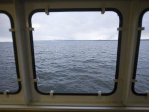 Looking Out a Ferry Boat Window on Lake Champlain by John Burcham