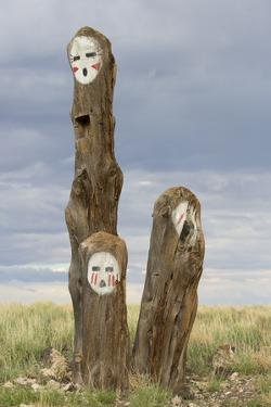 Painted Faces on Trees in the Navajo Reservation, Arizona by John Burcham