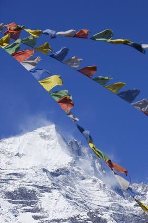 Prayer Flags in Front of Himalayan Mountain Range in Nepal by John Burcham