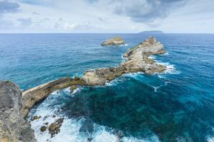 Rocky coast and turquoise Caribbean waters of Pointe des Chateaux. by John Burcham