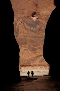 Silhouette of Two Hikers in Paria Canyon, Arizona by John Burcham