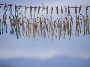 Souvenir Dream Catchers Against the Sky by John Burcham