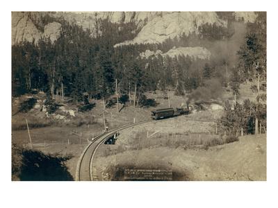 """Horse Shoe Curve."" on Burlington and Missouri River Railway. Buckhorn Mountains in Background"