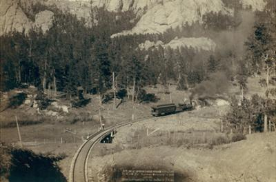 """Horse Shoe Curve."" on Burlington and Missouri River Railway. Buckhorn Mountains in Background"