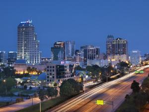 Usa, Florida, Orlando, Downtown Skyline and Interstate 4 by John Coletti