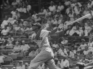 Action Shot of Chicago Cub's Ernie Banks, Following Direction of Baseball Resulting from His Hit by John Dominis