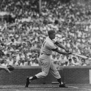 Action Shot of Chicago Cub's Ernie Banks Smacking the Pitched Baseball by John Dominis