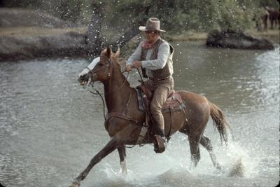 """Actor John Wayne During Filming of Western Movie """"The Undefeated"""""""