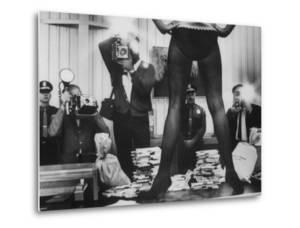 Actress Angie Dickinson's Lower Half Straddling a Million Dollars in Fake Money by John Dominis