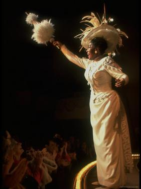 """Actress Pearl Bailey Pointing Parasol as Dolly Levi in Scene from Broadway Musical """"Hello Dolly"""" by John Dominis"""
