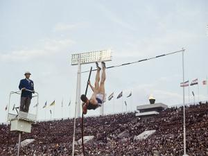 Athlete Clearing the Pole Vault at Summer Olympics by John Dominis