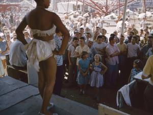 Audience Gathers to Watch a Dancer in a Two-Piece Costume at the Iowa State Fair, 1955 by John Dominis