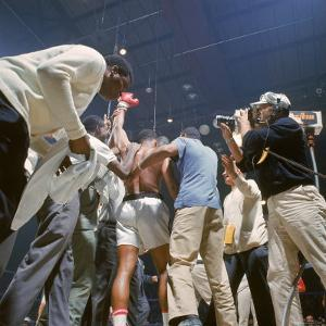 Boxer Cassius Clay, aka Muhammad Ali, Raising Fist in Triumph After Beating Sonny Liston by John Dominis