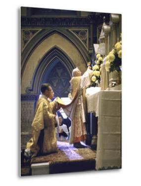 Cardinal Stritch Elevating Chalice after Transubstantiation During Mass by John Dominis