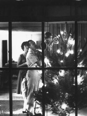 Christmas Tree Being Decorated by a Family Stationed at Guantanamo Naval Base by John Dominis
