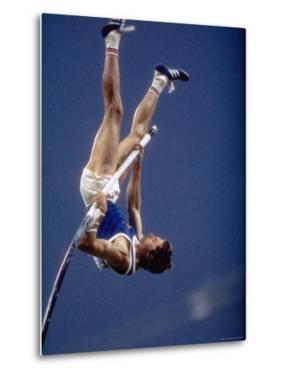East Germany's Wolfgang Nordwig in Action During Pole Vaulting Event at the Summer Olympics by John Dominis