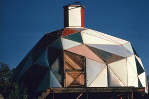 Exterior View of a Geodesic Dome House, with an Angled, Wooden Barn-Style Door by John Dominis