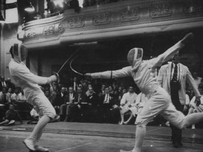 Fencers Competing in the Olympics by John Dominis