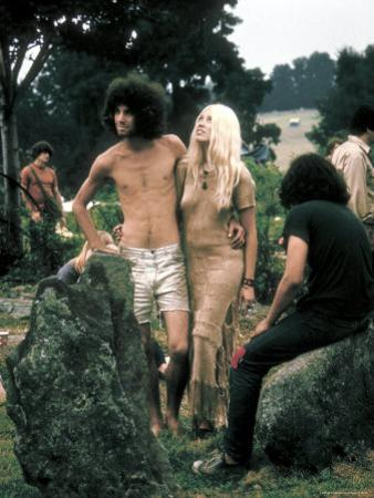 Hippie Couple Posed Together Arm in Arm with Others Around Them, During Woodstock Music/Art Fair