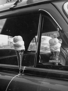 Ice Cream Cone Melting Outside Rolled Up Window of Air Conditioned Car by John Dominis