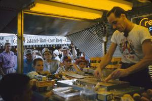 In a Booth at the Iowa State Fair, a Man Demonstrates 'Feemsters Famous Vegetable Slicer', 1955 by John Dominis