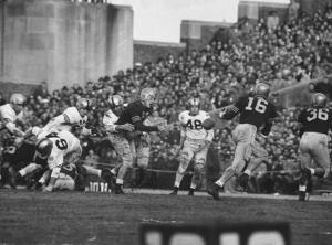 Navy Quaterback, George Welsh, Reaching Out to Complete Pass, During Army-Navy Game by John Dominis