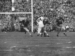 Navy Quaterback, George Welsh, Running, Grim-Faced, During Army-Navy Game by John Dominis