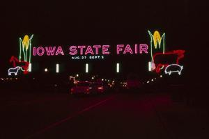 Nighttime View of the Illuminate Neon Sign at the Entrance to the Iowa State Fair, 1955 by John Dominis