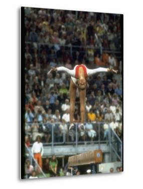 Soviet Gymnast Olga Korbut in Action on the Balance Beam at the Summer Olympics by John Dominis