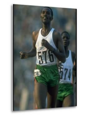 Track Athlete Kip Keino in Action at the Summer Olympics by John Dominis
