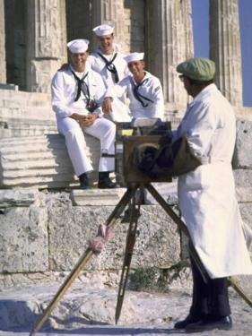 US Sailors Taking Photo at Greek Ruins by John Dominis