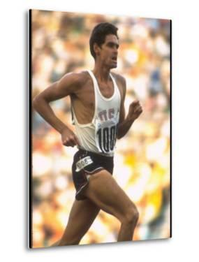 US Track Athlete Jim Ryun in Action at the Summer Olympics by John Dominis