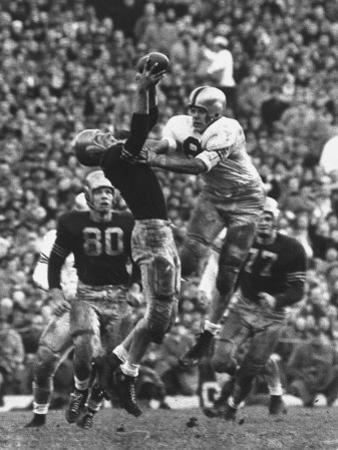 Violent Action: Don Helleder Trying to Retrieve Ball from Navy Defense During Army-Navy Game by John Dominis