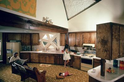 Walter Scale in the Kitchen of His Geodesic Dome House with His Children by John Dominis