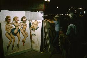 Women as They Pose Behind a Cut-Out of Burlesque Dancers, at the Iowa State Fair, 1955 by John Dominis