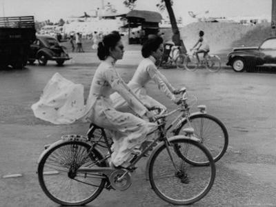 Women Riding Bicycles in Saigon