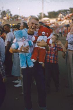 Young Man Holding Stuffed Bears Prizes at a Carnival Game at the Iowa State Fair, 1955 by John Dominis