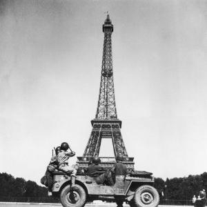 Soldiers of 4th US Infantry Division Looking at Eiffel Tower as They Liberate Capital City, WWII by John Downey