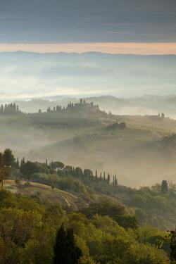 Early Morning View across Misty Hills from San Gimignano, Tuscany, Italy, Europe by John