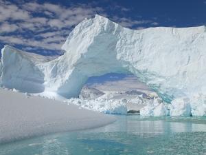 Huge Arch in Iceberg by John Eastcott & Yva Momatiuk
