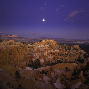 Moonrise over Bryce Canyon National Park by John Eastcott & Yva Momatiuk