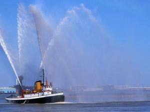 A Fireboat on the Mighty Mississippi River, Louisiana, USA by John Elk III