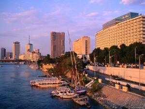 Cairo Hilton on Nile with Downtown in Background, Cairo, Egypt by John Elk III