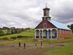 Children Playing Soccer in Front of Iglesia De Putchitco Church by John Elk III