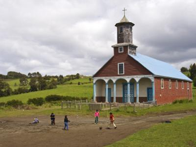 Children Playing Soccer in Front of Iglesia De Putchitco Church by John Elk III