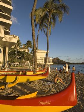 Outriggers on Waikiki Beach, Oahu, Hawaii by John Elk III
